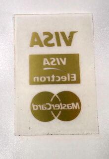Kultainen tarra läpinäkyvällä siirtokalvolla